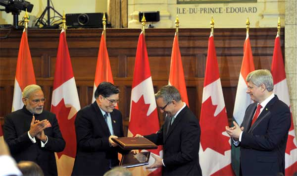 The Prime Minister, Narendra Modi and the Prime Minister of Canada, Stephen Harper witnessing the exchange of signed documents, in Ottawa, Canada on April 15, 2015.