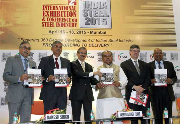 The Union Minister for Mines and Steel, Narendra Singh Tomar releasing the knowledge report book, at the inauguration of the international exhibition and conference on Steel Industry 'India Steel 2015', in Mumbai on April 16, 2015. The Secretary, Ministry of Steel, Rakesh Singh and other dignitaries are also seen.