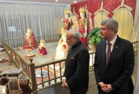 The Prime Minister, Narendra Modi and the Prime Minister of Canada, Stephen Harper visiting the Laxmi Narayan Temple