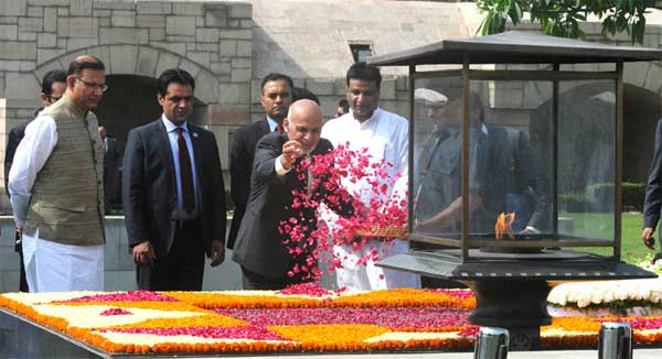 The President of the Islamic Republic of Afghanistan, Dr. Mohammad Ashraf Ghani paying floral tributes at the Samadhi of Mahatma Gandhi, at Rajghat, in Delhi on April 28, 2015. The Minister of State for Finance, Jayant Sinha is also seen.