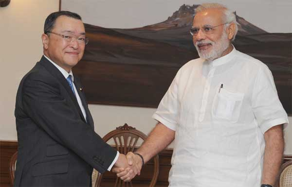 The Minister for Economy, Trade and Industry, Japan, Yoichi Miyazawa calls on the Prime Minister, Narendra Modi, in New Delhi on April 29, 2015.