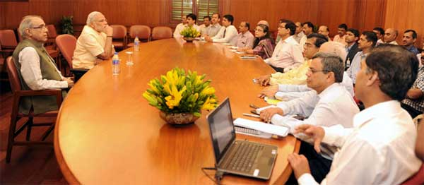 The Prime Minister, Narendra Modi interacting with the officers of the Prime Minister's Office, on the occasion of first anniversary of his Government, in New Delhi on May 26, 2015.