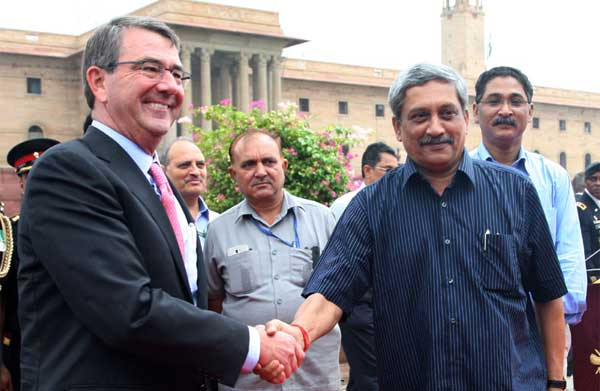 The Defence Secretary of US, Dr. Ashton Carter being received by the Union Minister for Defence, Manohar Parrikar, in New Delhi on June 03, 2015.