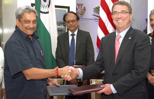 The Union Minister for Defence, Manohar Parrikar and the US Defence Secretary, Ashton Carter exchanging the signed document of the 2015 framework for the India – US defence relationship, in New Delhi on June 03, 2015. The Defence Secretary, G. Mohan Kumar is also seen.