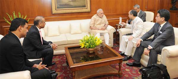 The Chairman and CEO, Soft Bank Corporation, Masayoshi Son, the Chairman, Bharti Enterprises, Sunil Bharti Mittal and the Senior MD of the Japan Bank for International Cooperation, Tadashi Maeda call on the Prime Minister, Narendra Modi, in New Delhi on June 22, 2015.