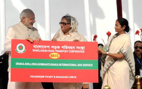 PM Narendra Modi being welcomed by the PM Bangladesh Sheikh Hasina fagging off the Dhaka-Shillong-Guwahati bus service in Dhaka