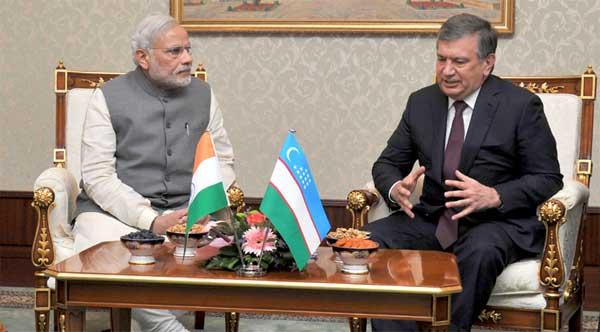 The Prime Minister, Narendra Modi meeting the Prime Minister of Uzbekistan, Shavkat Miromonovich Mirziyoyev at the Meeting Hall of Tashkent Airport, in Tashkent, Uzbekistan on July 06, 2015.