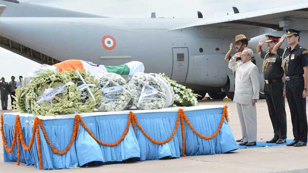 The President, Pranab Mukherjee paying homage at the mortal remains of the former President of India, Dr. A.P.J. Abdul Kalam, at Air Force Station, New Delhi on July 28, 2015.