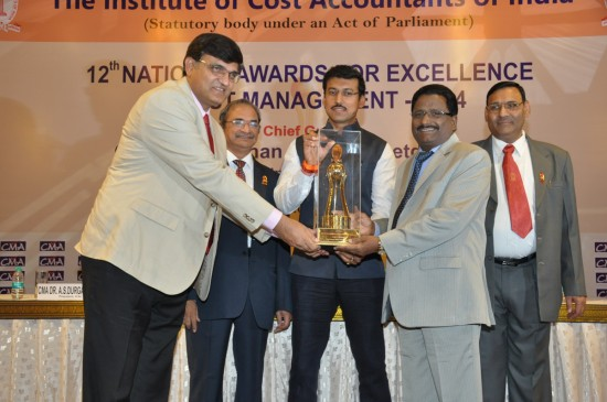 Rajyavardhan Rathore, Hon'ble Union Minister of State for Information & Broadcasting presenting the National Cost Management Award-2014, instituted by the Institute of Cost Accountants of India to Shri B. Surender Mohan, CMD NLC & Shri Rakesh Kumar, Director/Finance, NLC