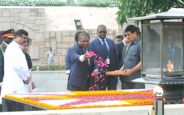 The President of the Republic of Mozambique, Filipe Jacinto Nyusi paying floral tributes at the Samadhi of Mahatma Gandhi, at Rajghat, in Delhi on August 05, 2015. The Minister of State for Petroleum and Natural Gas (Independent Charge), Dharmendra Pradhan is also seen.