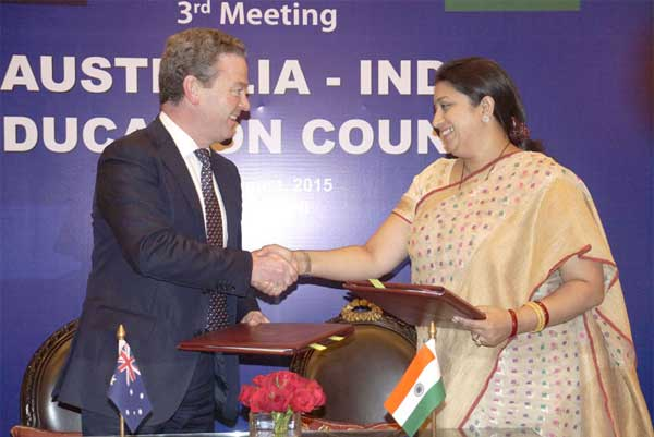 The Union Minister for Human Resource Development, Smriti Irani and the Minister for Education and Training, Australia, Christopher Pyne MP, exchanging the signed MoU on cooperation in the fields of education, training and research between the two countries, at the annual meeting of the Australia-India Education Council (AIEC) meeting, in New Delhi on August 24, 2015.