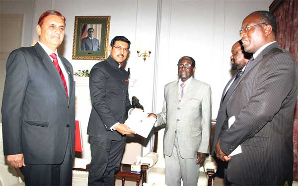 The Minister of State for Information & Broadcasting, Col. Rajyavardhan Singh Rathore meeting the President of the Republic of Zimbabwe Robert Gabriel Mugabe and extending an invitation to him for India-Africa Forum Summit (IAFS III), in Harare on August 27, 2015.