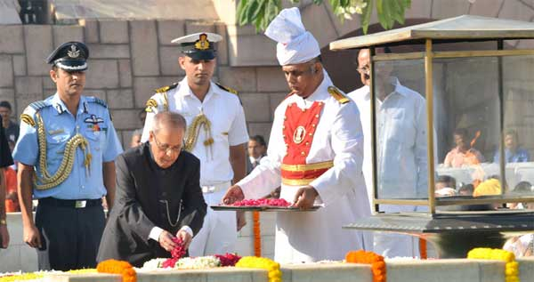 The President, Pranab Mukherjee paying floral tributes at the Samadhi of Mahatma Gandhi on his 146th birth anniversary, at Rajghat, in Delhi on October 02, 2015.