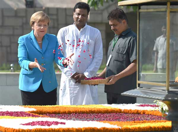 The German Chancellor, Dr. Angela Merkel paying floral tributes at the Samadhi of Mahatma Gandhi, at Rajghat, in Delhi on October 05, 2015.