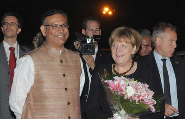 The German Chancellor, Angela Merkel being received by the Minister of State for Finance, Jayant Sinha, on her arrival, at Air Force Station Palam, in New Delhi on October 04, 2015.