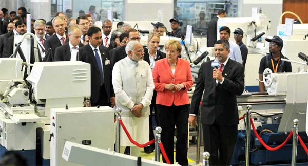 The Prime Minister, Narendra Modi and the German Chancellor, Dr. Angela Merkel visiting the Robert Bosch Engineering & Innovation Centre, in Bengaluru on October 06, 2015.