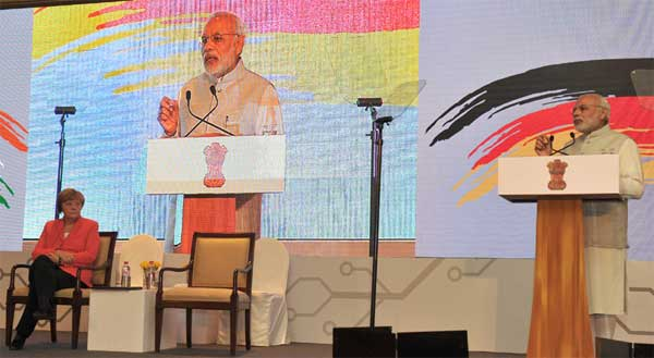 The Prime Minister, Narendra Modi addressing at the Indo-German Summit 2015, organised by the NASSCOM & Frauenhofer Institute, in Bengaluru on October 06, 2015. The German Chancellor, Dr. Angela Merkel is also seen.