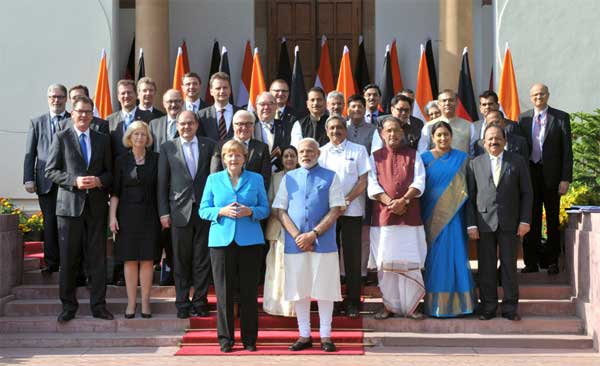The Prime Minister, Narendra Modi and the German Chancellor, Dr. Angela Merkel in the family photograph with German delegation and the Indian dignitaries, at Hyderabad House, in New Delhi on October 05, 2015.