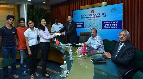 CMD ONGC Mr. D. K. Sarraf handing over the prizes to the enthusiastic students. Also seen in picture CVO ONGC Dr. A. K. Ambasht and Director (Finance) ONGC Mr. A. K. Srinivasan (on the extreme right)