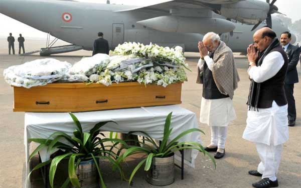The Prime Minister, Narendra Modi paying homage at the mortal remains of Mufti Mohammad Sayeed, at Palam Airport, in New Delhi on January 07, 2016. The Union Home Minister, Rajnath Singh is also seen.
