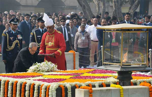 The President, Pranab Mukherjee laying wreath at the Samadhi of Mahatma Gandhi on the occasion of Martyr's Day, at Rajghat, in Delhi on January 30, 2016.