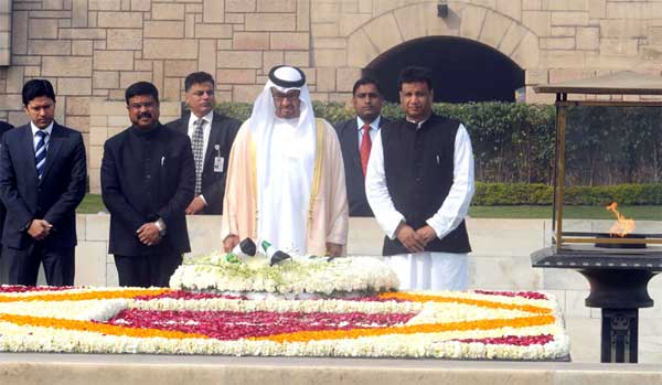 The Prime Minister, Shri Narendra Modi receiving the Crown Prince of Abu Dhabi paying homage at the Samadhi of Mahatma Gandhi, at Rajghat, in Delhi on February 11, 2016. The Minister of State for Petroleum and Natural Gas (Independent Charge), Dharmendra Pradhan is also seen.