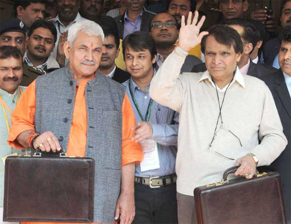The Union Minister for Railways, Suresh Prabhakar Prabhu leaving Rail Bhawan for Parliament House to present the Railway Budget 2016-17, in New Delhi on February 25, 2016. The Minister of State for Railways, Manoj Sinha is also seen.