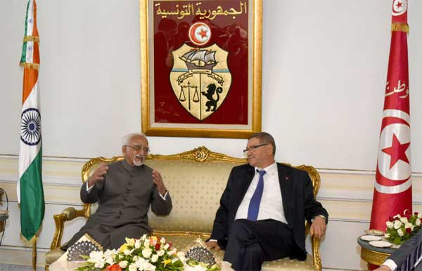 The Vice President, M. Hamid Ansari with the Prime Minister of Tunisia, Habib Essid on his arrival, in Tunisia on June 02, 2016.