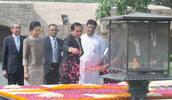 The Prime Minister of the Kingdom of Thailand, General Prayut Chan-o-cha paying floral tributes at the Samadhi of Mahatma Gandhi, at Rajghat, in Delhi on June 17, 2016. Naraporn Chan-o-cha is also seen.
