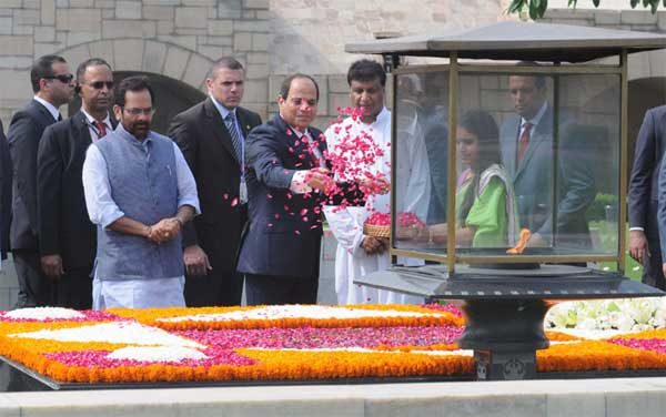 The President of the Arab Republic of Egypt, Abdel Fattah el-Sisi paying floral tributes at the Samadhi of Mahatma Gandhi, at Rajghat, in Delhi on September 02, 2016. The Minister of State for Minority Affairs (Independent Charge) and Parliamentary Affairs, Mukhtar Abbas Naqvi is also seen.