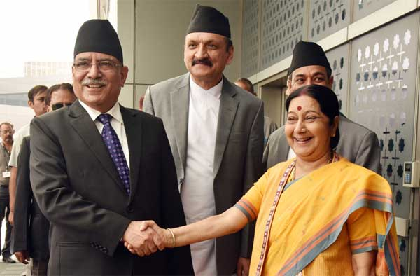 The Prime Minister of Nepal, Pushpa Kamal Dahal being received by the Union Minister for External Affairs, Sushma Swaraj, on his arrival, in New Delhi on September 15, 2016.
