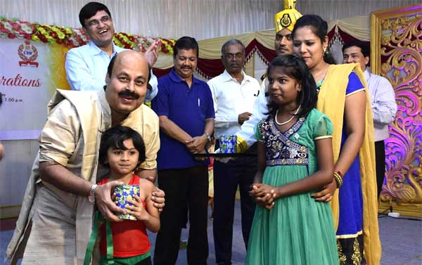 Dr.Sarat Kumar Acharya, CMD, NLCI distributing Diwali Gifts to children of CISF during the Diwali celebrations held at CISF Complex, former Fertilizer Factory Complex, Neyveli. Also seen are Functional Directors, NLCI.