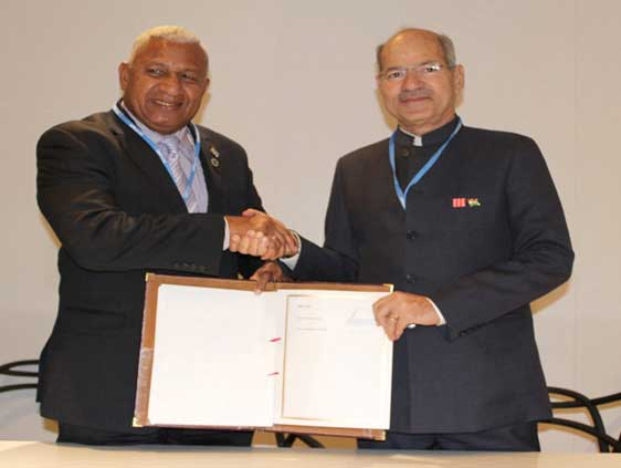 The Prime Minister of Fiji, Frank Bainimarama with the Minister of State for Environment, Forest and Climate Change (Independent Charge), Anil Madhav Dave after signing the Framework Agreement of the International Solar Alliance, at the India Pavilion at COP 22, in Marrakech, Morocco on November 16, 2016.