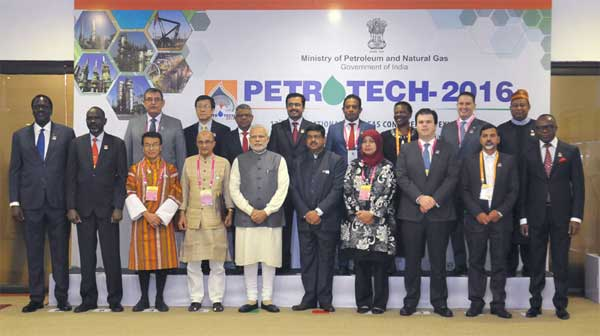 The Prime Minister, Narendra Modi in a group photograph at the PETROTECH-2016: 12th International Oil & Gas Conference and Exhibition, in New Delhi on December 05, 2016. The Minister of State for Petroleum and Natural Gas (Independent Charge), Dharmendra Pradhan is also seen.