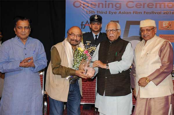 Uttar Pradesh, Governor Shri Ram Naik felicitating veteran film maker Shri Govind Nihalani with 'Asian Film Culture Award at the inaugural function of 15th Third Eye Asian Film Festival. Also seen are Shri Sudhir Nandgaonkar (in left) and Shri Kiran Shantaram (in right)
