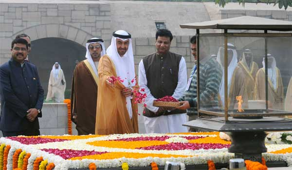 The Crown Prince of Abu Dhabi, Deputy Supreme Commander of U.A.E. Armed Forces, General Sheikh Mohammed Bin Zayed Al Nahyan paying floral tributes at the Samadhi of Mahatma Gandhi, at Rajghat, in Delhi on January 25, 2017. The Minister of State for Petroleum and Natural Gas (Independent Charge), Dharmendra Pradhan is also seen.