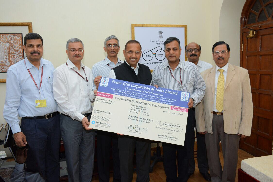 Powergrid CMD I S Jha presents Cheque of rs 30 cr Secretary Expenditure, Ministry of Finance for Swachh Bharat Kosh
