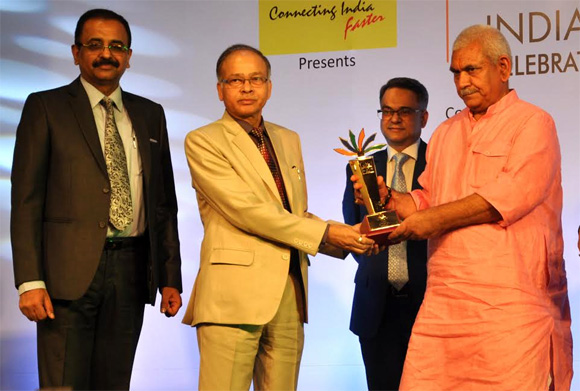 "Shri K.M. Singh, CMD, NHPC and Shri Balraj Joshi, Director (Technical), NHPC receiving the India Pride Award conferred to NHPC for ""Excellence in CSR/Environment Protection and Conservation"" fromShri Manoj Sinha, Hon'ble Union Minister of State (Independent Charge), Ministry of Communications and Union Minister of State, Ministry of Railways, Government of India"