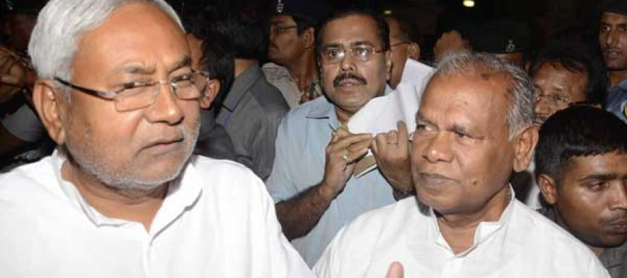 Newly elected Bihar Chief Minister Jitan Ram Majhi with JD-U leader Nitish Kumar as they come out of Raj Bhawan in Patna.