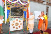 The PM, Narendra Modi unveiling the plaque to lay the foundation stone of Bhutan-India Cooperation Kholongchhu Hydroelectric Project
