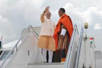 The Prime Minister, Narendra Modi waving to the dignitaries, on his departure from Bhutan to Delhi, on June 16, 2014.