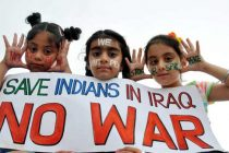 Children hold a placard reading 'Save Indians in Iraq – No War' in Amritsar on June 23, 2014.