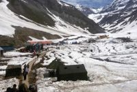 A view of snow-clad Sheshnag base camp in Jammu and Kashmir on June 27, 2014.