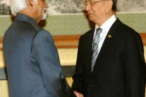 The Vice President, Mohd. Hamid Ansari meeting the Myanmar President, Thein Sein, at Diaoyutai State House, in China.