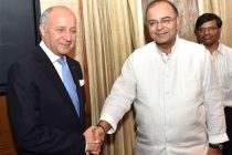 The Foreign Minister of France, Laurent Fabius meeting the Minister for Finance, Corporate Affairs and Defence, Arun Jaitley