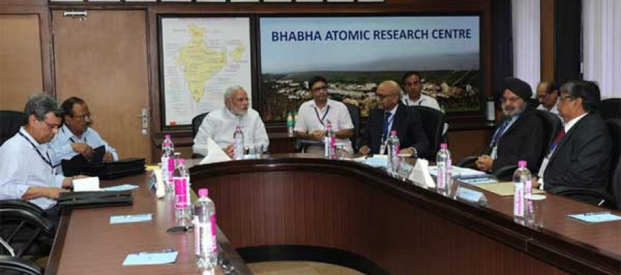 The Prime Minister, Narendra Modi being briefed by the Secretary DAE and Chairman, AEC, Dr. R.K Sinha