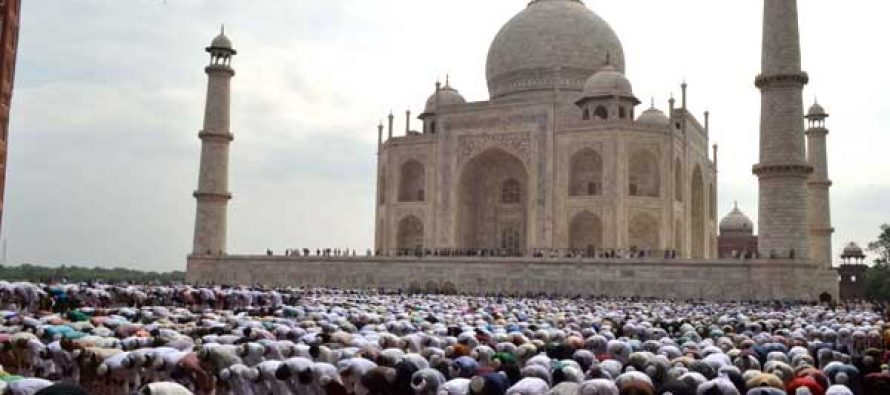 Muslims offer prayers on occassion of Eid-ul-Fitr at the Taj Mahal in Agra on July 29, 2014.