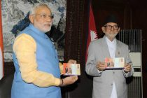 The Prime Minister, Narendra Modi with the Prime Minister of Nepal, Sushil Koirala releasing the commemorative of stamps