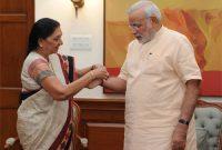 Chief Minister of Gujarat, Anandiben Patel tie rakhi on Prime Minister, Narendra Modi
