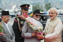Prime Minister, Shri Narendra Modi being received by the Prime Minister of Nepal, Shri Sushil Koirala on his arrival, at Tribhuvan International Airport, Kathmandu, Nepal